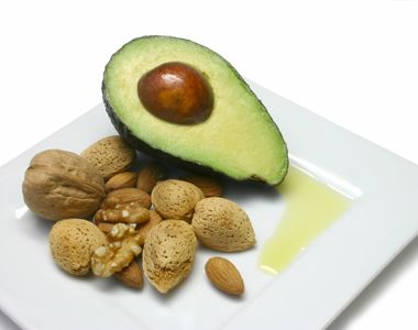 Avocado half with nuts on a plate